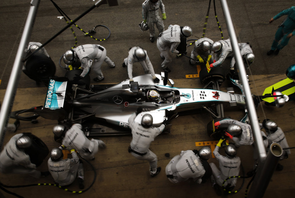 Photo - AP10ThingsToSee - Mercedes driver Lewis Hamilton, of Britain, gets a pit service during the Spain Formula One Grand Prix at the Barcelona Catalunya racetrack in Montmelo, near Barcelona, Spain, Sunday, May 11, 2014. (AP Photo/Emilio Morenatti)