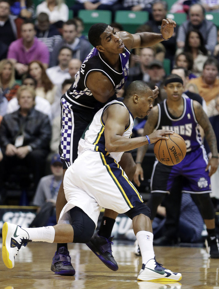 Photo - Utah Jazz's Randy Foye (8) drives around Sacramento Kings' Jason Thompson, rear, in the first quarter during an NBA basketball game Monday, Feb. 4, 2013, in Salt Lake City. (AP Photo/Rick Bowmer)