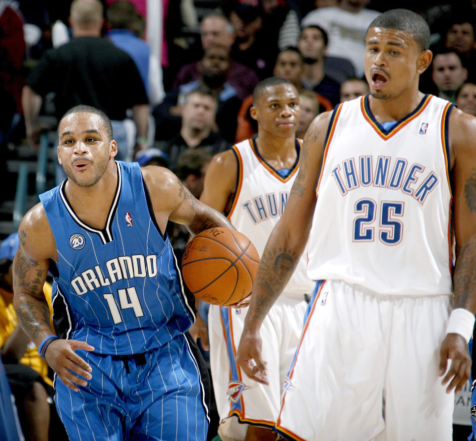 Orlando\'s Jameer Nelson reacts in front of Oklahoma City\'s Russell Westbrook, center, and Earl Watson during the NBA basketball game between the Oklahoma City Thunder and the Orlando Magic at the Ford Center in Oklahoma City, Wednesday, Nov. 12, 2008. BY BRYAN TERRY, THE OKLAHOMAN