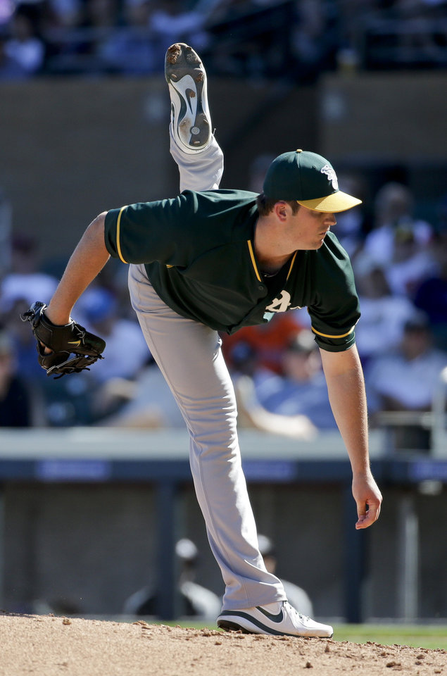 Photo - Oakland Athletics pitcher Drew Pomeranz throws against the Colorado Rockies during the third inning of a spring training baseball game in Scottsdale, Ariz., Saturday, March 8, 2014. (AP Photo/Chris Carlson)