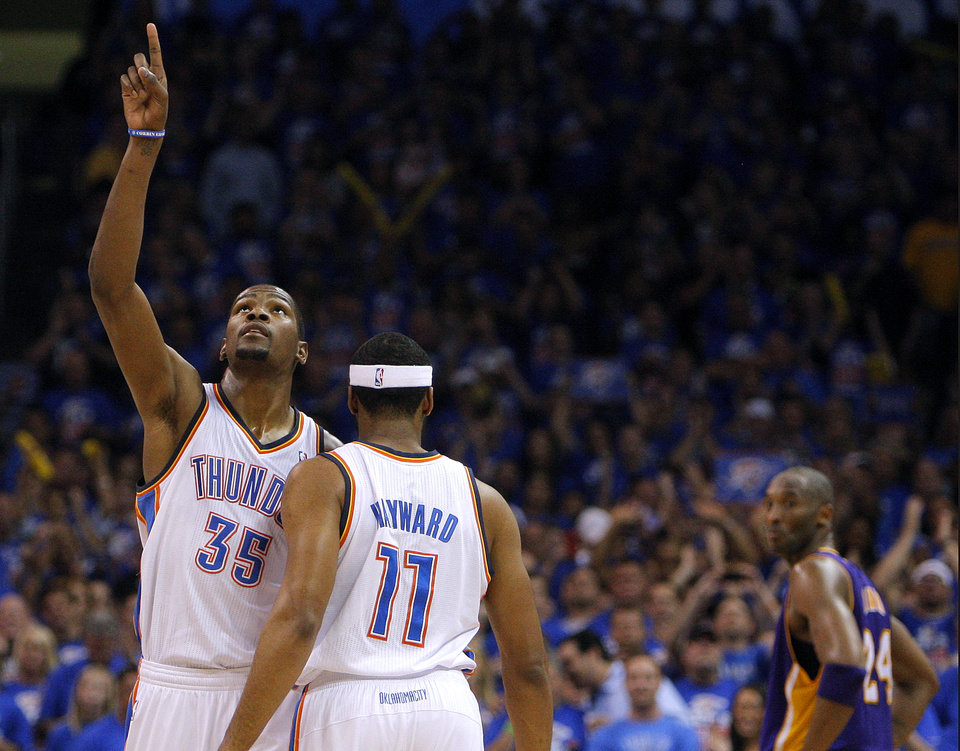 Photo - Oklahoma City's Kevin Durant (35) celebrates with Lazar Hayward (11) and Los Angeles' Kobe Bryant (24) looks on during Game 5 in the second round of the NBA playoffs between the Oklahoma City Thunder and the L.A. Lakers at Chesapeake Energy Arena in Oklahoma City, Monday, May 21, 2012. Photo by Sarah Phipps, The Oklahoman