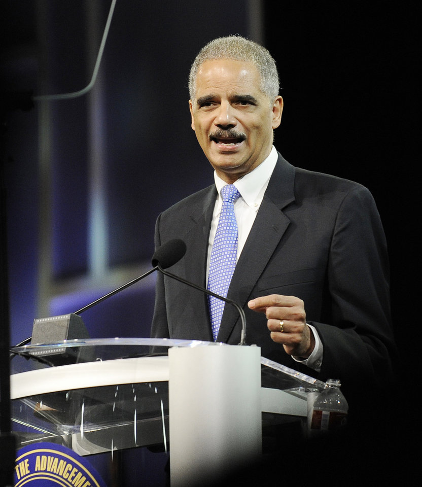 Photo -   Attorney General Eric Holder speaks at the NAACP annual convention Tuesday, July 10, 2012, in Houston. Holder says he opposes a new photo ID requirement in Texas elections because it would be harmful to minority voters. (AP Photo/Pat Sullivan)