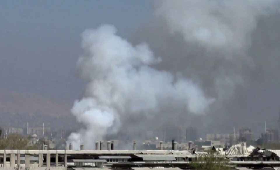 Photo - In this image taken from video obtained from the Shaam News Network, which has been authenticated based on its contents and other AP reporting, smoke rises from buildings due to shelling in Damascus, Syria, on Thursday, March 28, 2013. (AP Photo/Shaam News Network via AP video)