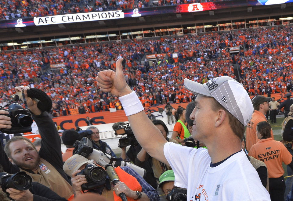 Photo - Denver Broncos quarterback Peyton Manning flashes a thumbs up after the AFC Championship NFL playoff football game against the New England Patriots in Denver, Sunday, Jan. 19, 2014. The Broncos defeated the Patriots 26-16 to advance to the Super Bowl. (AP Photo/Jack Dempsey)