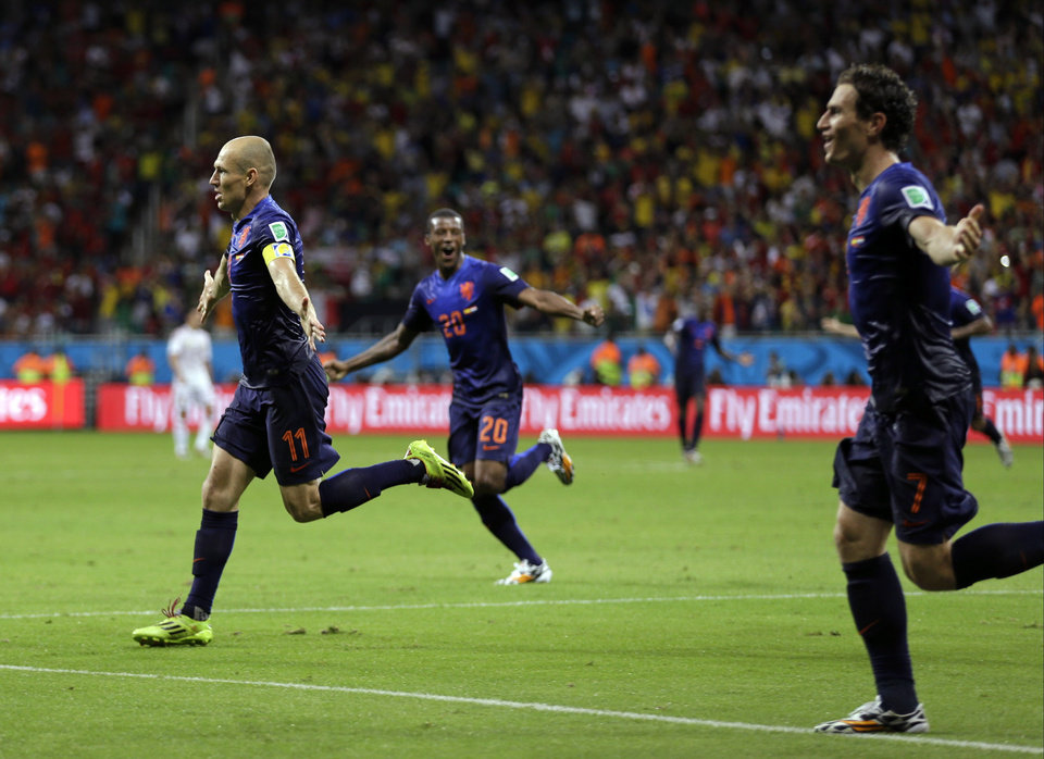 Photo - Netherlands' Arjen Robben celebrates after scoring his side's fifth goal during the second half of the group B World Cup soccer match between Spain and the Netherlands at the Arena Ponte Nova in Salvador, Brazil, Friday, June 13, 2014.  (AP Photo/Natacha Pisarenko)