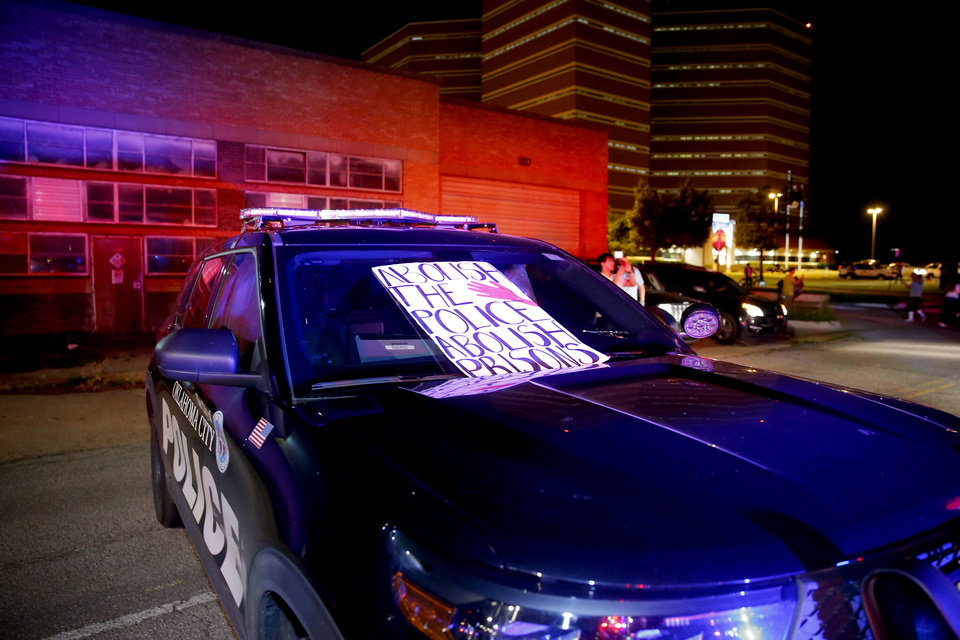 Photo - A sign on an Oklahoma City police vehicle is seen during a protest outside the Oklahoma City Police Department in Oklahoma City, Saturday, May 30, 2020. The protest was in response to the death of George Floyd. [Bryan Terry/The Oklahoman]