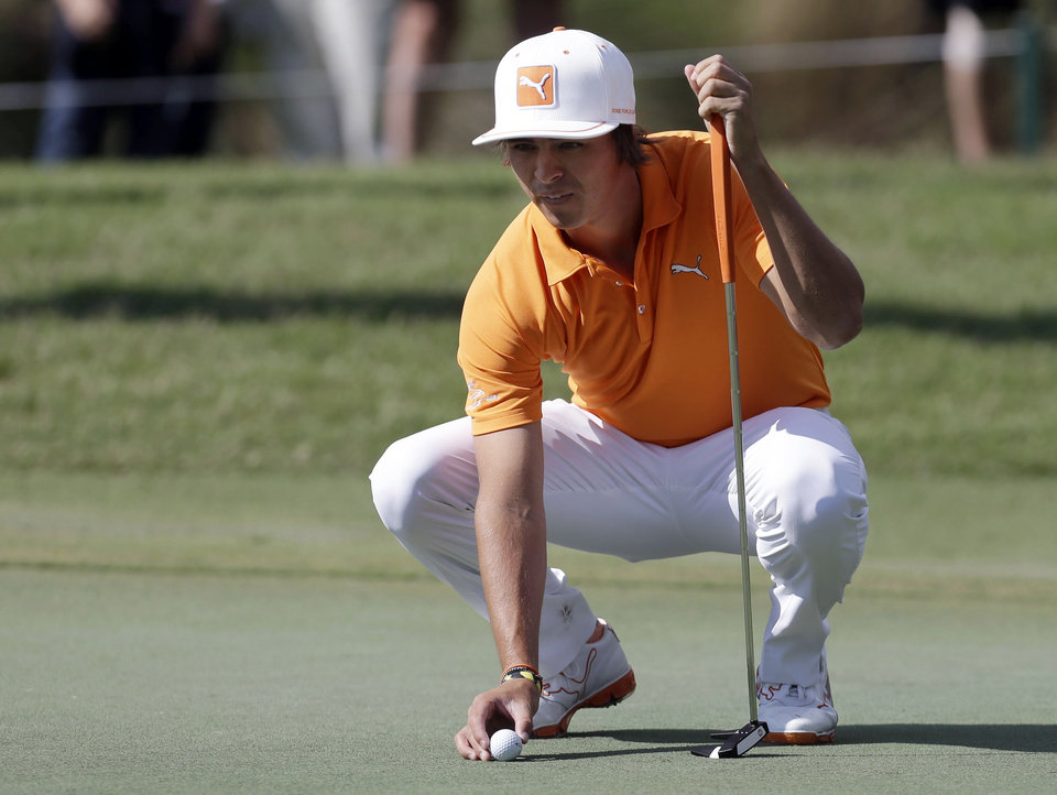 Rickie Fowler lines up a putt on the sixth green during a practice round at The Players Championship golf tournament at TPC Sawgrass in Ponte Vedra Beach, Fla., Tuesday, May 7, 2013. (AP Photo/Gerald Herbert) ORG XMIT: FLGH108