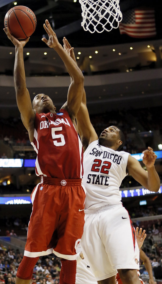 Oklahoma\'s Je\'lon Hornbeak (5) takes a shot against San Diego State\'s Chase Tapley (22) during a game between the University of Oklahoma and San Diego State in the second round of the NCAA men\'s college basketball tournament at the Wells Fargo Center in Philadelphia, Friday, March 22, 2013. San Diego State beat OU, 70-55. Photo by Nate Billings, The Oklahoman