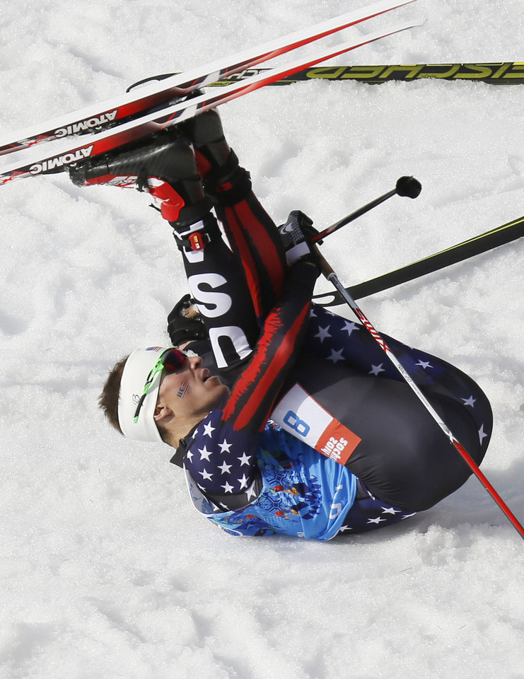 Photo - United States' Bill Demong stretches after finish the cross-country portion of the Nordic combined Gundersen large hill team competition at the 2014 Winter Olympics, Thursday, Feb. 20, 2014, in Krasnaya Polyana, Russia. (AP Photo/Dmitry Lovetsky)