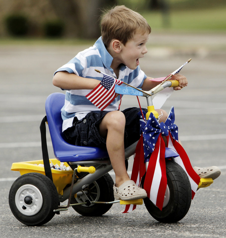 Cooper Shapard, 4, rides around the parking lot of the Quail Creek Golf and Country Club before the Quail Creek Fourth of July parade in Oklahoma City, Saturday, July 4, 2009. Photo by Nate Billings, The Oklahoman