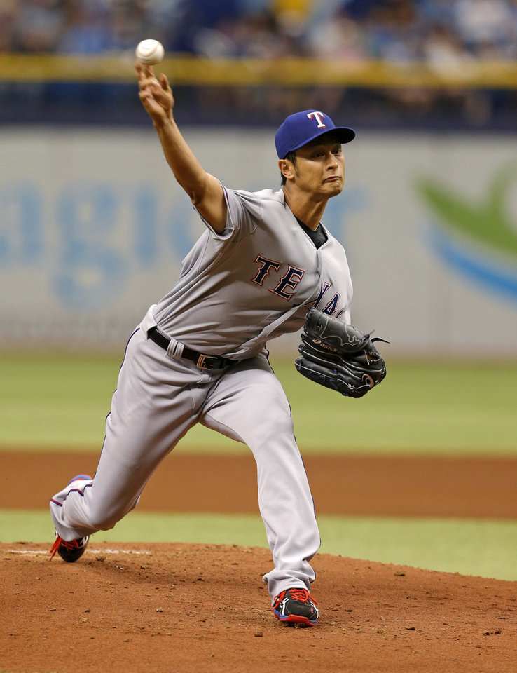 Photo - Texas Rangers starting pitcher Yu Darvish throws during the first inning of a baseball game against the Tampa Bay Rays, Sunday, April 6, 2014, in St. Petersburg, Fla. (AP Photo/Mike Carlson)