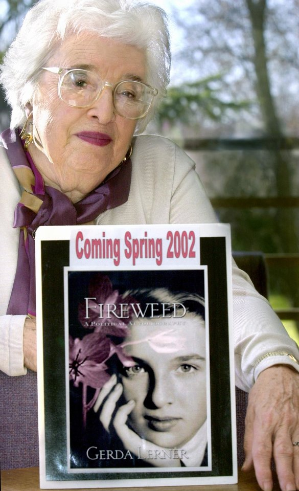 This 2001 photo shows  Gerda Lerner, founder of University of Wisconsin-Madison's graduate program in women's history, with an image of her autobiography, Fireweed. Lerner, a founding member of the National Organization for Woman and a pioneer in the field of women�s history, has died at an assisted-living facility in Madison. She was 92. (AP Photo/Wisconsin State Journal, Sarah B. Tews)