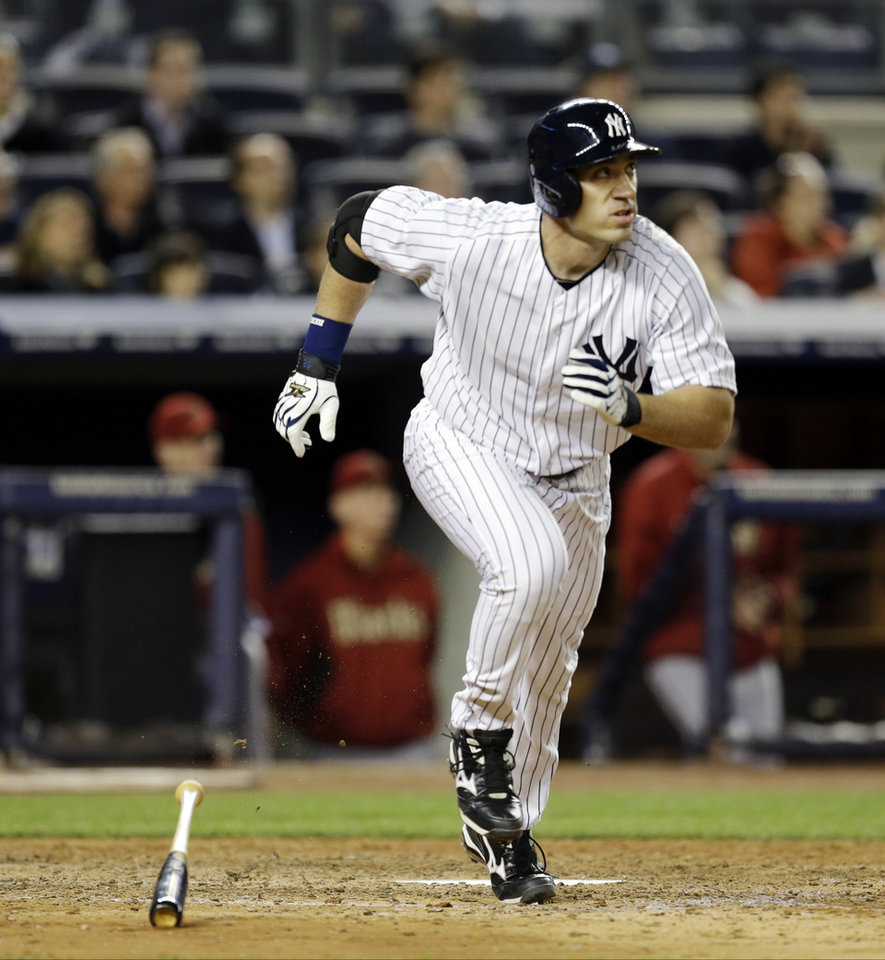 New York Yankees designated hitter Travis Hafner watches his eighth-inning, solo home run in a baseball game against the Arizona Diamondbacks at Yankee Stadium in New York, Wednesday, April 17, 2013. (AP Photo/Kathy Willens)