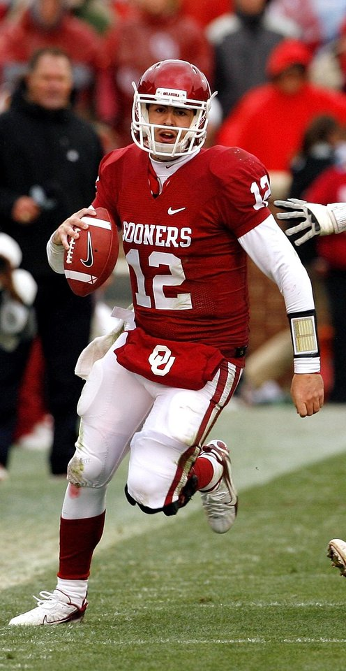 Photo - Sooner quareterback Landry Jones (12) scrambles during the second half of a college football game in which  the University of Oklahoma Sooners (OU) defeated the Iowa State University Cyclones (ISU) 26-6 at Gaylord Family-Oklahoma Memorial Stadium in Norman, Okla., Saturday, Nov. 26, 2011. Photo by Steve Sinsey, The Oklahoman