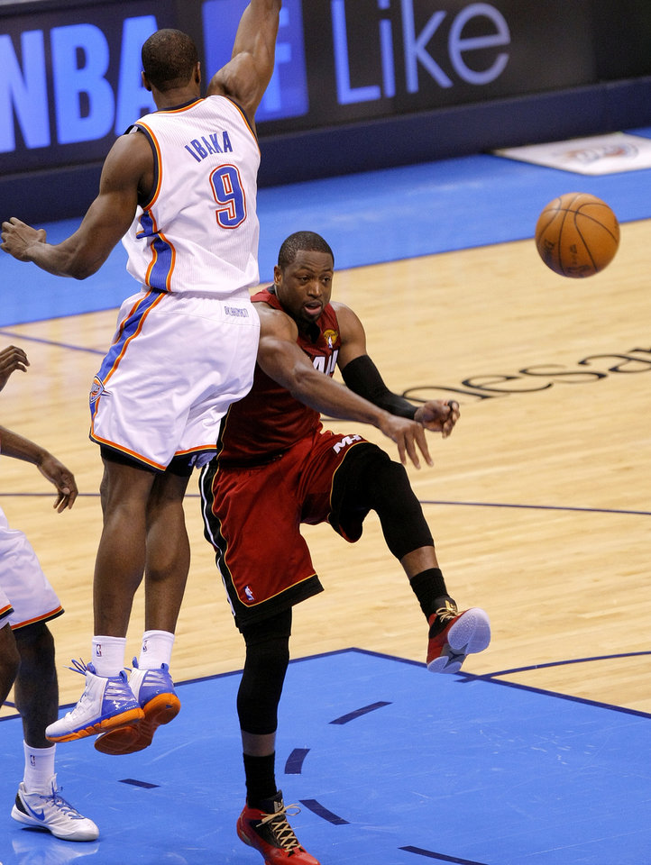 Miami's Dwyane Wade (3) passes the ball beside Oklahoma City's Serge Ibaka (9) during Game 1 of the NBA Finals between the Oklahoma City Thunder and the Miami Heat at Chesapeake Energy Arena in Oklahoma City, Tuesday, June 12, 2012. Photo by Sarah Phipps, The Oklahoman