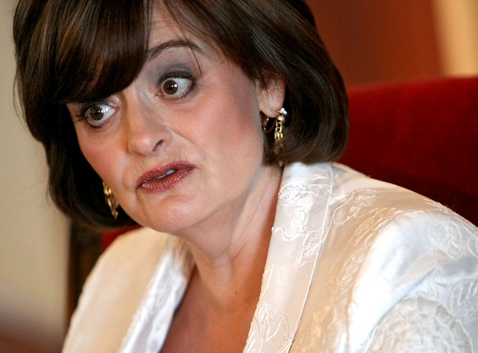 Photo - WIFE OF THE UNITED KINGDOM'S FORMER PRIME MINISTER TONY BLAIR: Cherie Blair talks with reporters at the Skirvin Hilton Hotel  in Oklahoma City on Tuesday, Sept. 22, 2009.  By John Clanton, The Oklahoman ORG XMIT: KOD