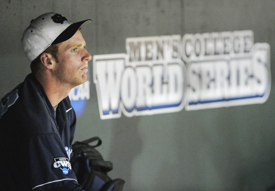 North Carolina's Colin Moran sits dejected in the dugout after losing 4-1 to UCLA in an NCAA College World Series baseball game in Omaha, Neb., Friday, June 21, 2013. (AP Photo/Eric Francis)