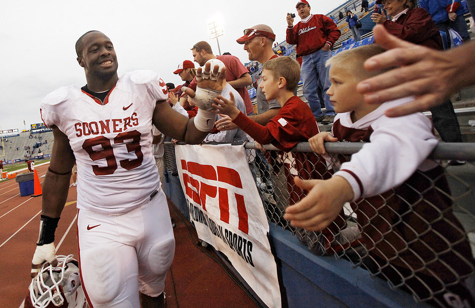 Photo - Oklahoma's Gerald McCoy (93) greets fans after the college football game between the University of Oklahoma Sooners (OU) and the University of Kansas Jayhawks (KU) on Saturday, Oct. 24, 2009, in Lawrence, Kan. Oklahoma won the game 35-13. Photo by Chris Landsberger, The Oklahoman ORG XMIT: KOD