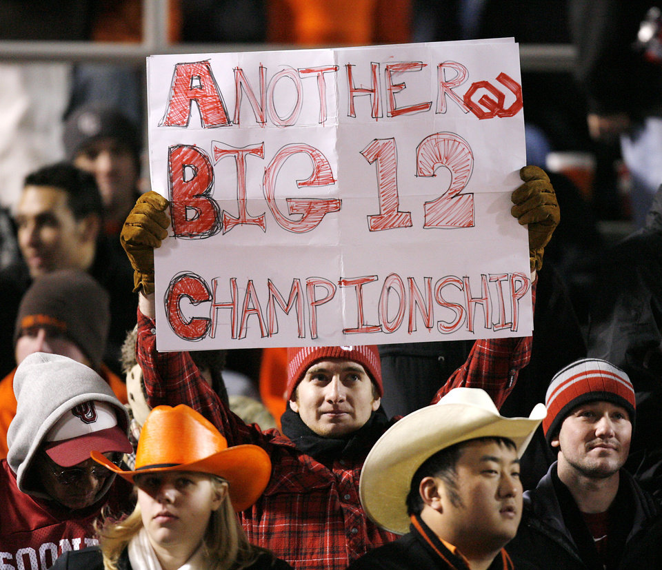 An Oklahoma fan holds up a sign during OU's 61-41 win over OSU during the second half of the college football game between the University of Oklahoma Sooners (OU) and Oklahoma State University Cowboys (OSU) at Boone Pickens Stadium on Saturday, Nov. 29, 2008, in Stillwater, Okla. STAFF PHOTO BY CHRIS LANDSBERGER
