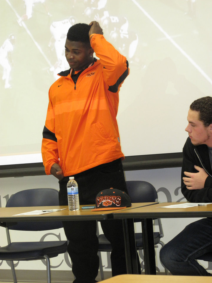 OSU signee Jeremiah Tshimanga address the crowd gathered for his signing ceremony. PHOTO BY GINA MIZELL, The Oklahoman <strong></strong>
