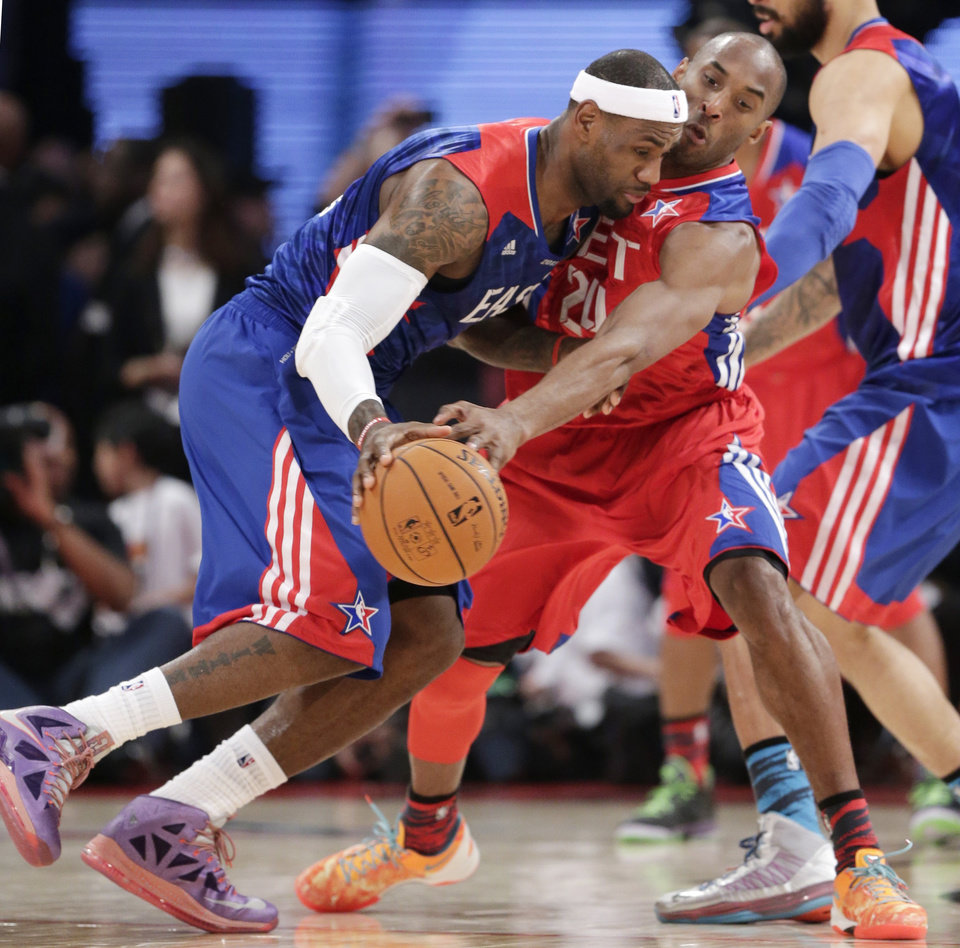 Photo - East Team's LeBron James of the Miami Heat is defended by West Team's Kobe Bryant of the Los Angeles Lakers during the first half of the NBA All-Star basketball game Sunday, Feb. 17, 2013, in Houston. (AP Photo/Eric Gay)