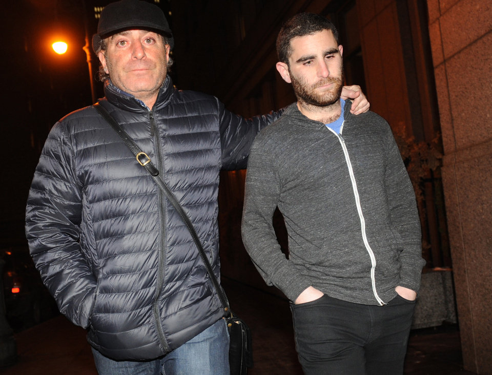 Photo - FILE - In this Jan. 27, 2014 file photo, Charlie Shrem, right, exits Manhattan federal court with an unidentified person, in New York. The New York Bitcoin operator is set to plead guilty, Thursday, Sept. 4, 2014, in a case stemming from the black market website Silk Road shutdown. (AP Photo/ Louis Lanzano, File)