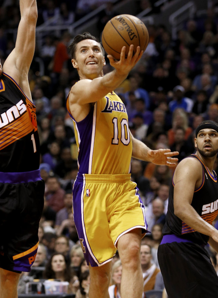 Photo - Los Angeles Lakers' Steve Nash (10) shoots against the Phoenix Suns during the first half of an NBA basketball game, Wednesday, Jan. 30, 2013, in Phoenix. (AP Photo/Matt York)