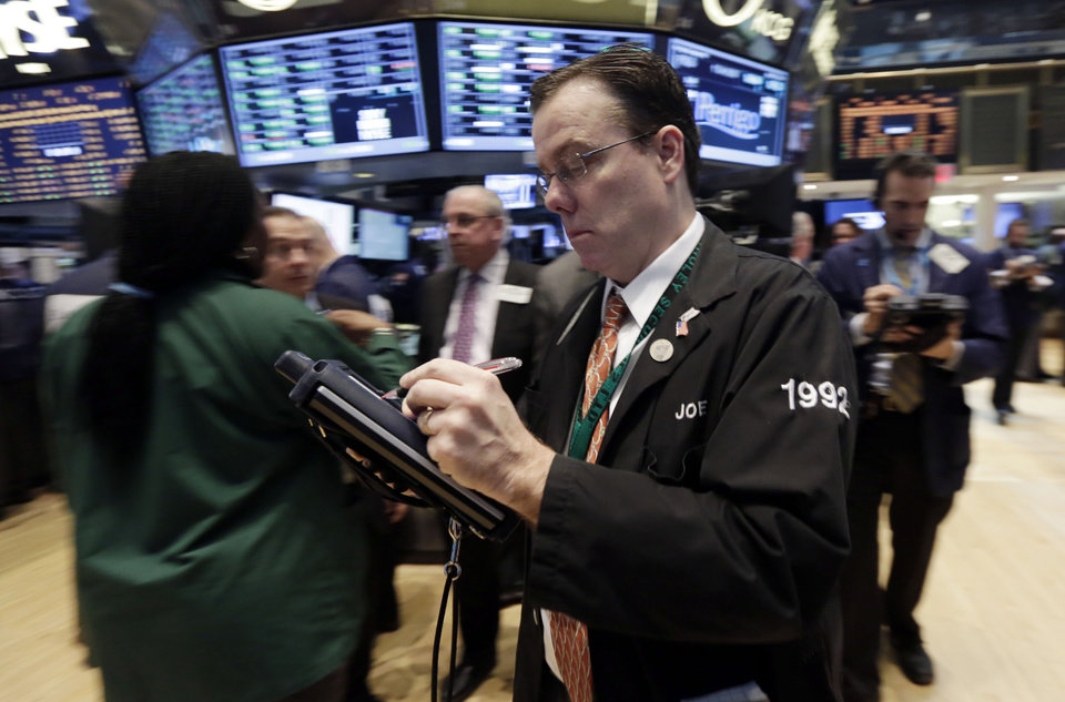 Photo - Trader Joseph Murray works on the floor of the New York Stock Exchange, Tuesday, March 4, 2014. Relieved investors sent stocks sharply higher Tuesday after Russia pulled troops back from the border of Ukraine. The rally erased steep losses from Monday caused by fears an escalating conflict. (AP Photo/Richard Drew)