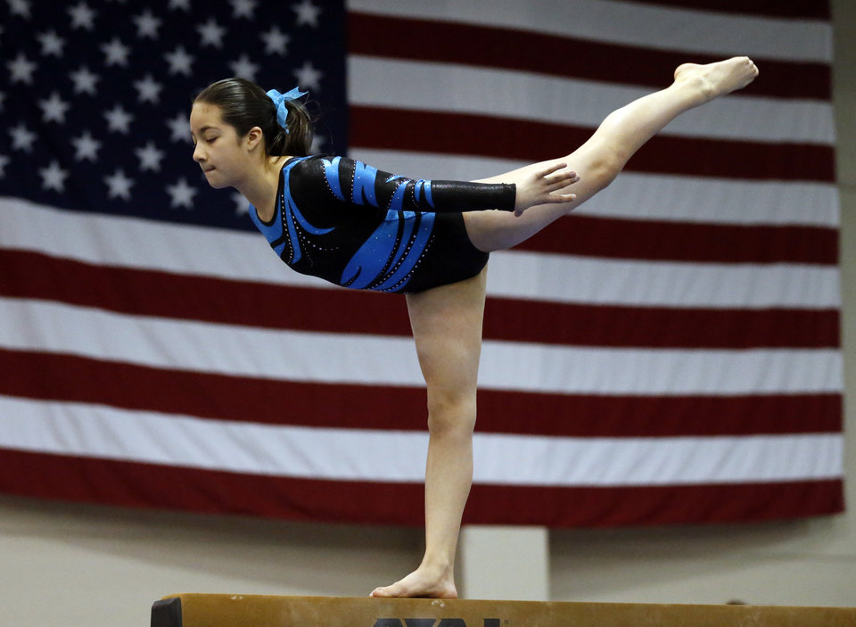 Photo - Erica Pedraza, 11, with Hopes and Dreams Gymnastics in Springdale, Ark., warms up on the balance beam during the Nadia Comaneci Invitational Sports Festival on Saturday, Feb. 16, 2013  in Oklahoma City, Okla. Photo by Steve Sisney, The Oklahoman