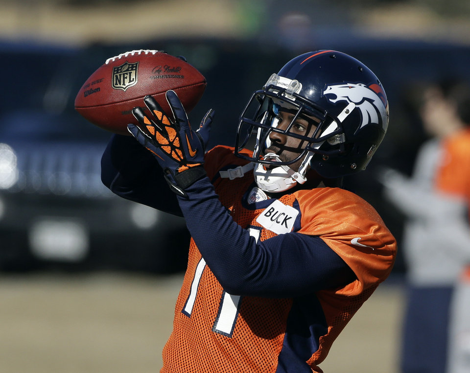 Denver Broncos wide receiver Trindon Holliday pulls in a pass at football practice at the team's training facility in Englewood, Colo., on Wednesday, Jan.9,  2013. The Broncos are scheduled to play the Baltimore Ravens in an NFL playoff game on Saturday. (AP Photo/Ed Andrieski)