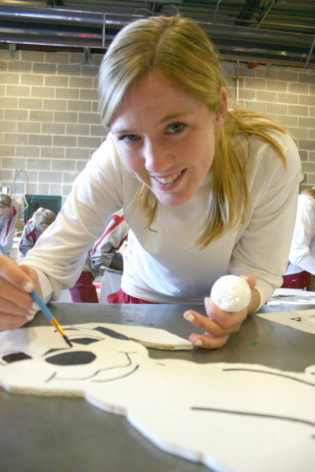 University of Oklahoma women�s soccer team member Ashley Farrand is painting a nose on one of 50 Dalmatian puppy cutouts at the J. D. McCarty Center. Farrand, a sophomore midfielder from Jenks, Oklahoma, was one of 18 OU soccer players who volunteered to work on this 101 Dalmatian Christmas project for the McCarty Center. The J. D. McCarty Center is a pediatric rehab hospital for children with developmental disabilities in Norman.<br/><b>Community Photo By:</b> Greg Gaston<br/><b>Submitted By:</b> Greg, Norman