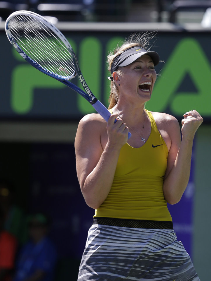 Photo - Maria Sharapova, of Russia, reacts after defeating Petra Kvitova, 7-5, 6-1 at the Sony Open Tennis tournament, Tuesday, March 25, 2014, in Key Biscayne, Fla. (AP Photo/Lynne Sladky)