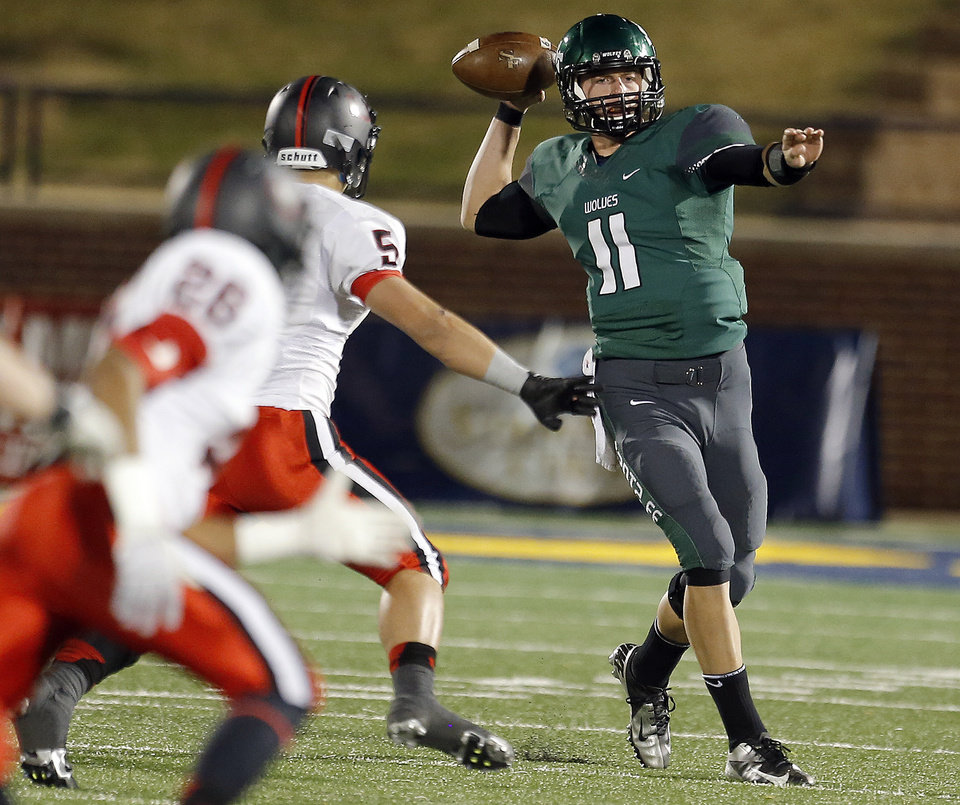 Photo - Edmond Santa Fe's Justice Jansen throws the ball during the high school football game between Edmond Santa Fe and Union at Wantland Stadium in Edmond, Okla.,  Friday, Nov. 16, 2012. Photo by Sarah Phipps, The Oklahoman