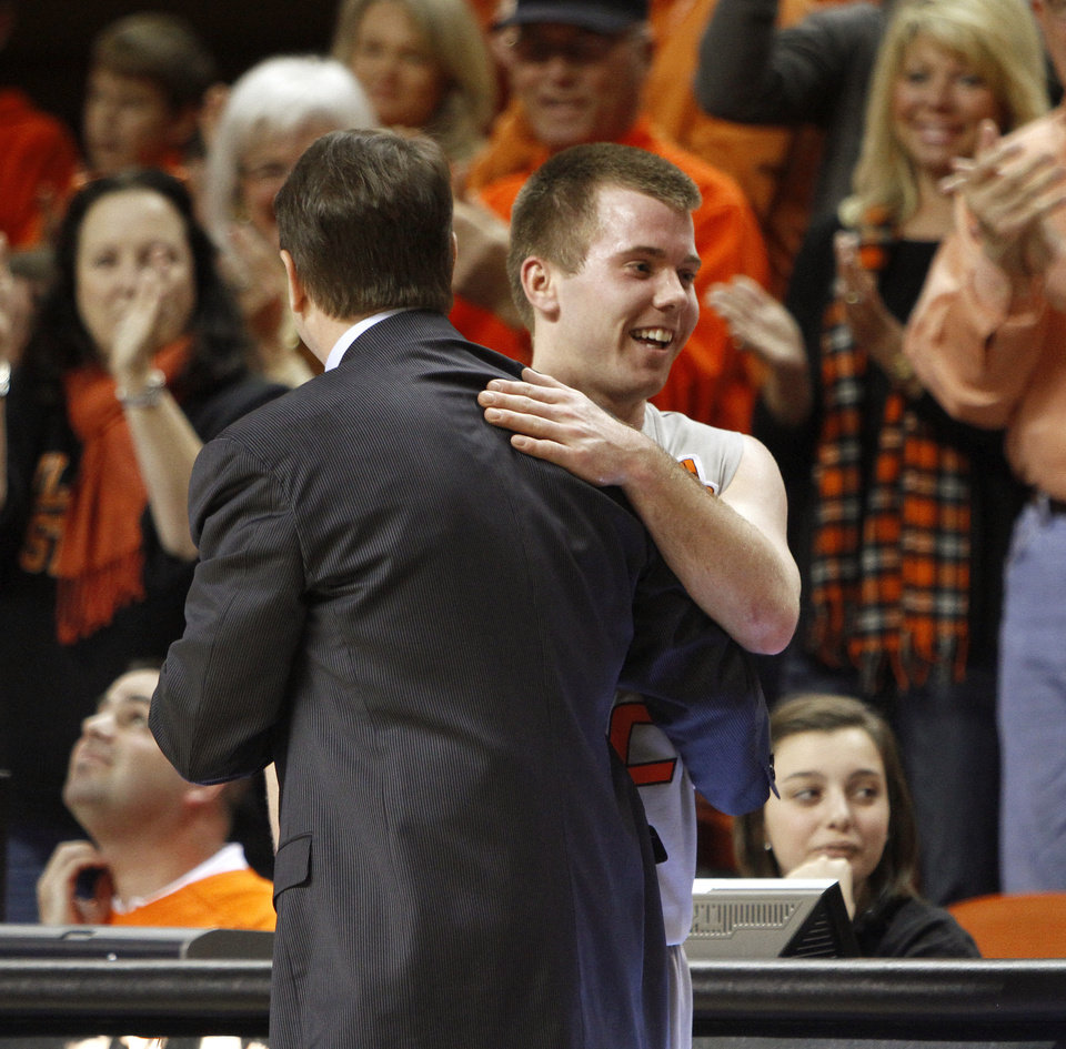 Oklahoma State\'s Keiton Page is congratulated by coach Travis Ford as he leaves the game during an NCAA college basketball game between Oklahoma State University (OSU) and the University of Texas (UT) at Gallagher-Iba Arena in Stillwater, Okla., Saturday, Feb. 18, 2012. Oklahoma State won 90-78. Photo by Bryan Terry, The Oklahoman
