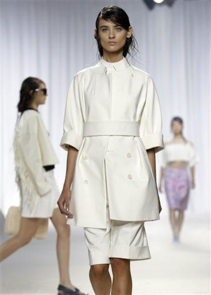Photo -  The 3.1 Phillip Lim Spring 2014 collection is modeled during Fashion Week in New York,  Monday, Sept. 9, 2013. (AP Photo/Richard Drew)