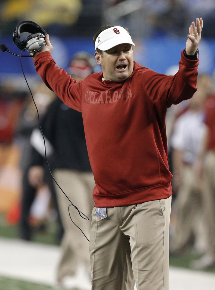 Photo - Oklahoma coach Bob Stoops reacts during the Cotton Bowl college football game between the University of Oklahoma (OU)and Texas A&M University at Cowboys Stadium in Arlington, Texas, Friday, Jan. 4, 2013. Oklahoma lost 41-13. Photo by Bryan Terry, The Oklahoman