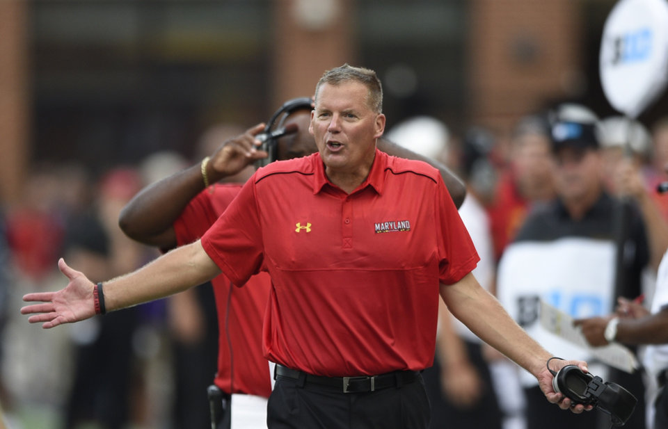 Photo - Maryland head coach Randy Edsall gestures during the second half of an NCAA college football game against James Madison, Saturday, Aug. 30, 2014, in College Park, Md. Maryland won 52-7. (AP Photo/Nick Wass)
