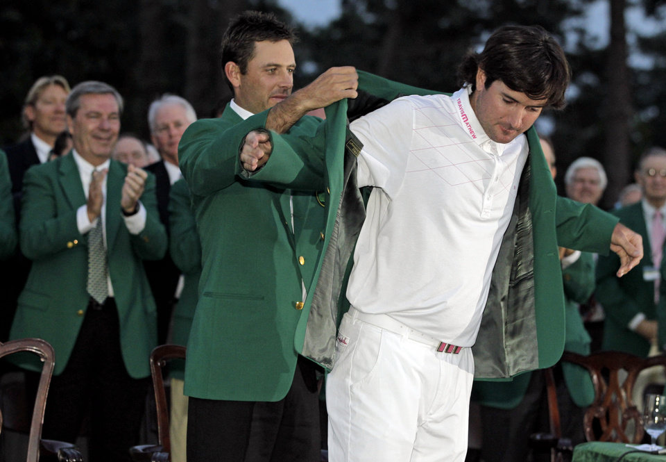 FILE- In this April 8, 2012, file photo, Charl Schwartzel, left, of South Africa, helps Bubba Watson put on the winner\'s green jacket after winning the Masters golf tournament on the 10th hole after a sudden death playoff in Augusta, Ga. Among the most pressing question for 2013: What will Watson serve for dinner at the Masters? (AP Photo/Darron Cummings, File)