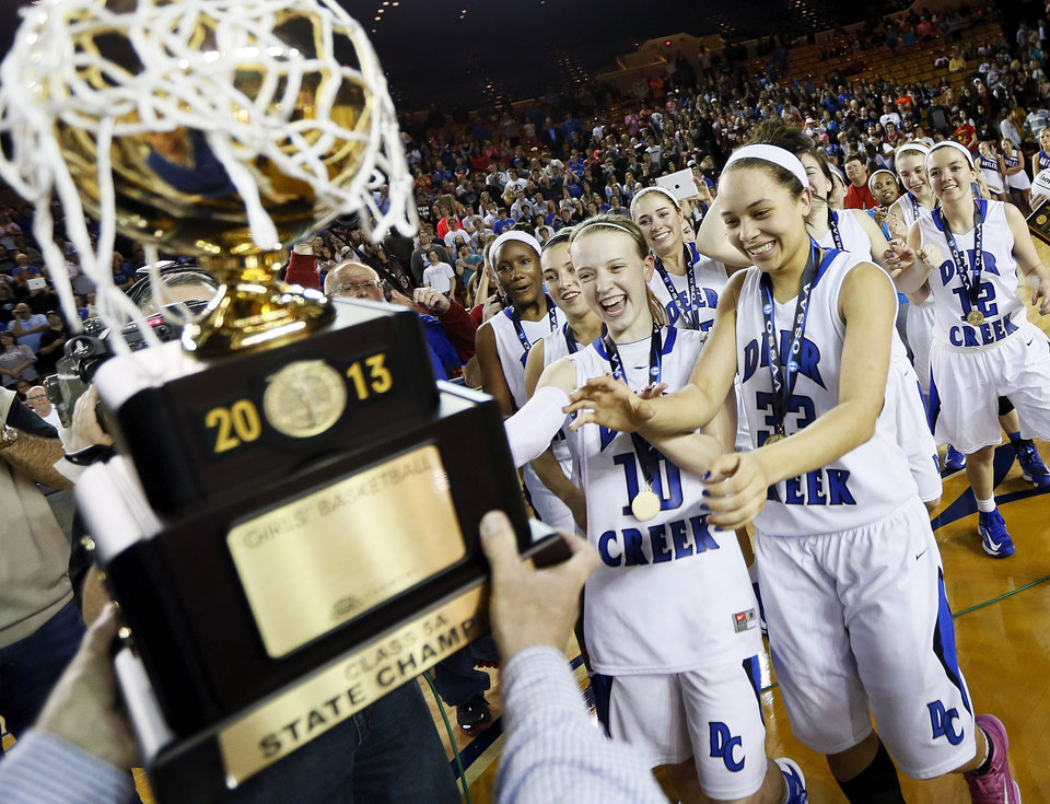Deer Creek's Alexa Adair (10), left, and Ashley Gibson (33) take the gold ball after the Antlers won the Class 5A girls championship high school basketball game in the state tournament at the Mabee Center in Tulsa, Okla., Saturday, March 9, 2013. Deer Creek defeated Shawnee, 59-44. Photo by Nate Billings, The Oklahoman