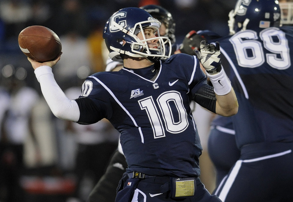 Photo - Connecticut quarterback Chandler Whitmer (10) throws during the first half of an NCAA college football game against Cincinnati at Rentschler Field in East Hartford, Conn., Saturday, Dec. 1, 2012. (AP Photo/Jessica Hill)