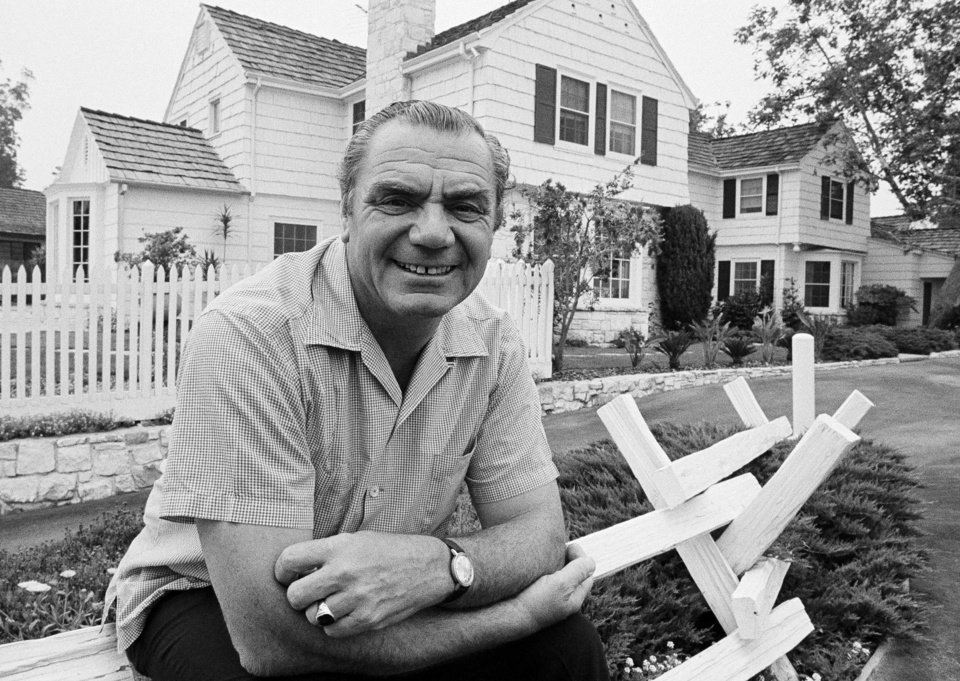 FILE - In this July 1, 1969, file photo, actor Ernest Borgnine poses  in front of his home in the mountains above Hollywood, Calif.  A spokesman said Sunday, July 8, 2012, that Borgnine has died at the age of 95. (AP Photo/George Brich, File) ORG XMIT: NY810