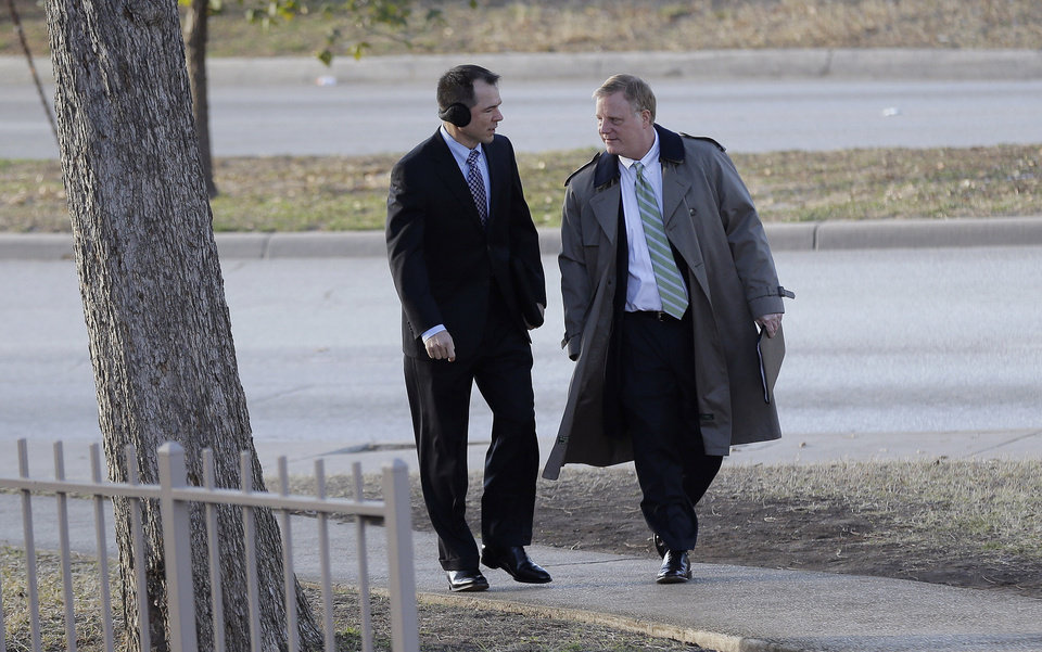Photo - File - In the Feb. 12, 2014 file photo, Victor Holmes, left, and partner Mark Phariss, right, arrive at the U.S. Federal Courthouse, in San Antonio, where a federal judge is expected to hear arguments in a lawsuit challenging Texas' ban on same-sex marriage. Republican attorneys general across the U.S. are fighting court rebukes of same-sex marriage bans in their states. But Texas' Greg Abbott is doing so against extraordinary personal ties: Phariss, one of the gay men challenging the law here is an old friend. (AP Photo/Eric Gay, File)