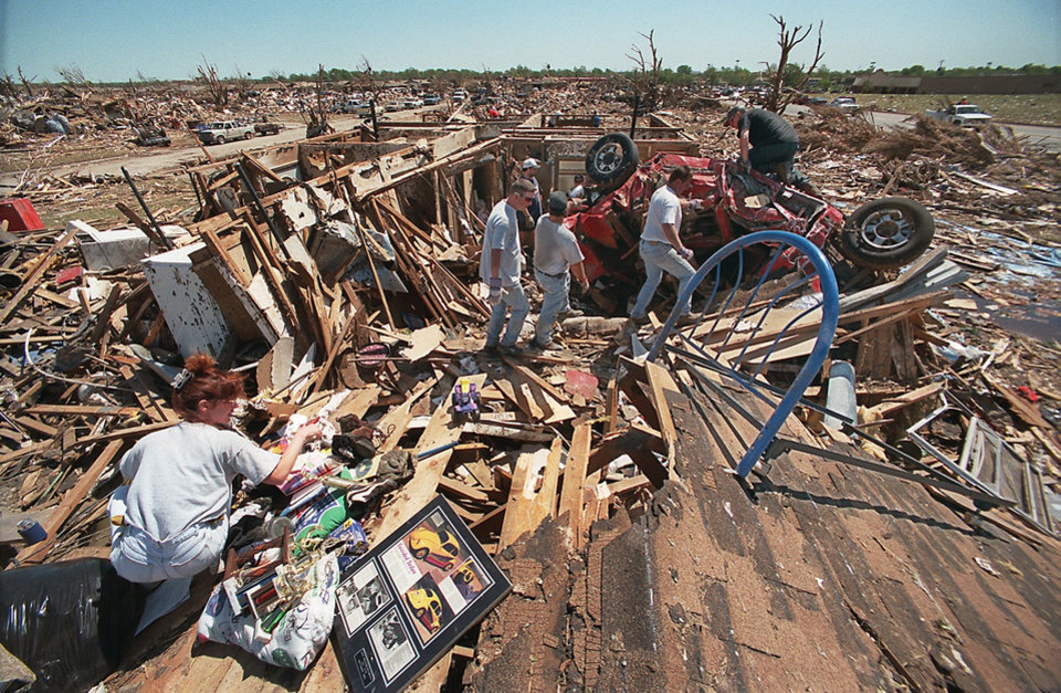 MAY 3, 1999 TORNADO: Tornado victims, damage: Mark and Brenda Meadors home in Del Aire housing addition. The car that is in what was once their living room belongs to an unknown person.