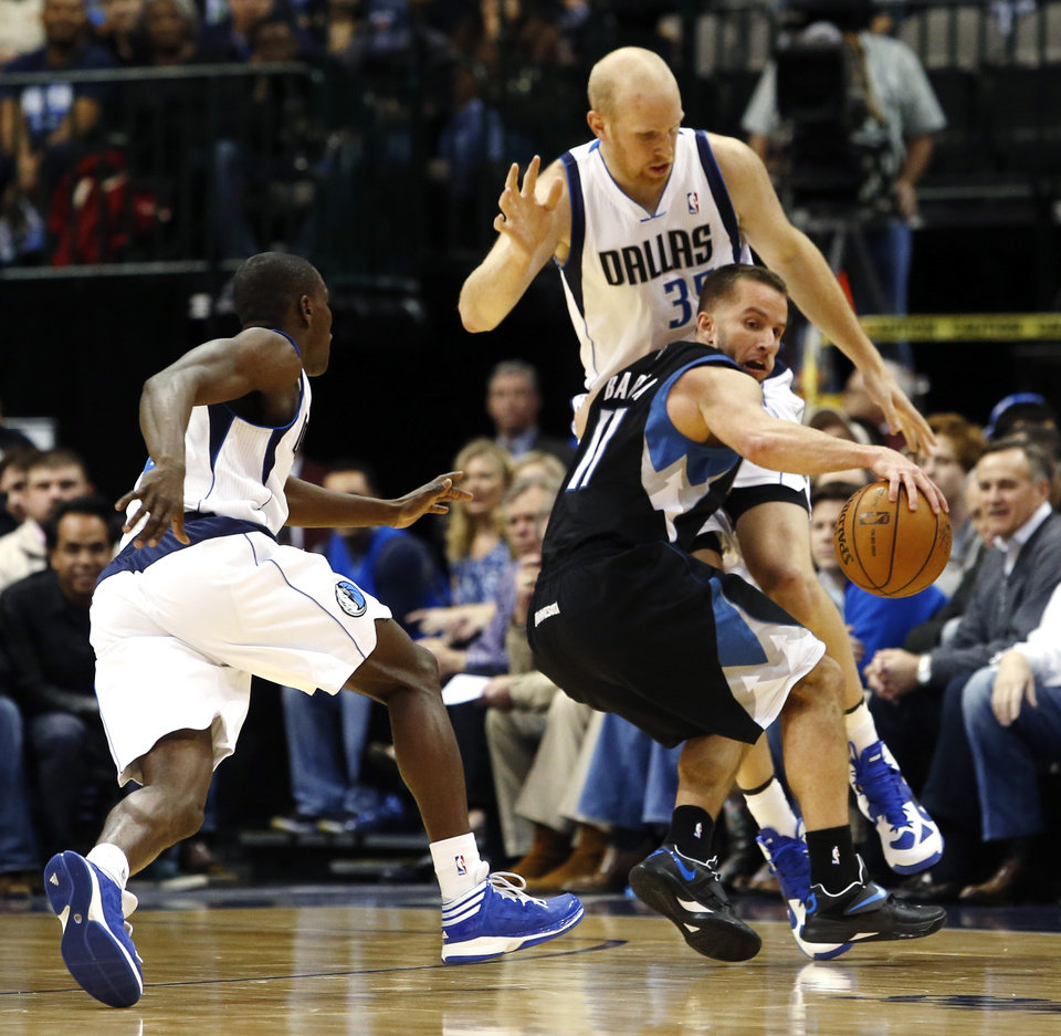 Photo - Dallas Mavericks guard Darren Collison, left, and center Chris Kaman (35) defend against Minnesota Timberwolves guard Jose Juan Barea (11) during the second half of an NBA basketball game, Monday, Jan. 14, 2013, in Dallas. The Mavericks won 113-98. (AP Photo/Sharon Ellman)