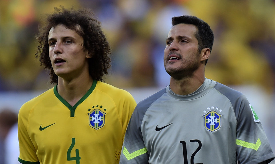 Photo - Brazil's David Luiz, left.and goalkeeper Julio Cesar prepare for a penalty shoot out at the end of the World Cup round of 16 soccer match between Brazil and Chile at the Mineirao Stadium in Belo Horizonte, Brazil, Saturday, June 28, 2014. Brazil won the match 3-2 on penalties after the match ended 1-1. (AP Photo/Martin Meissner)