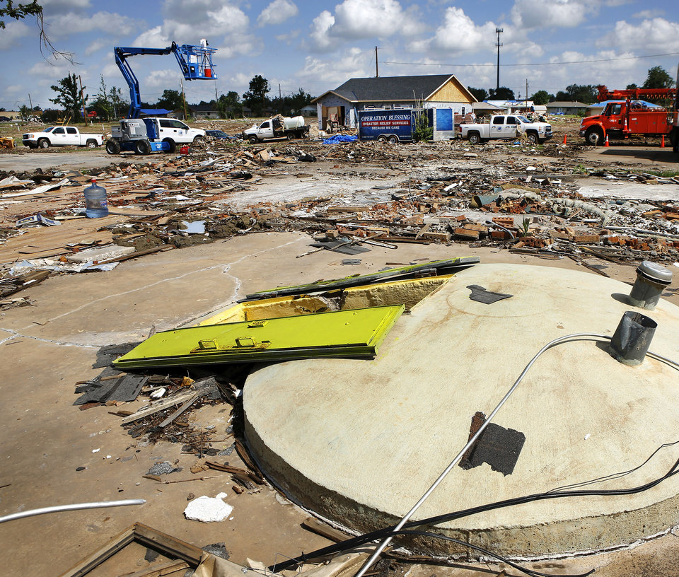 Doors remain open on this tornado shelter in an area of Moore that was heavily damaged in the May 20 tornado. PHOTO BY JIM BECKEL, THE OKLAHOMAN <strong>Jim Beckel - THE OKLAHOMAN</strong>