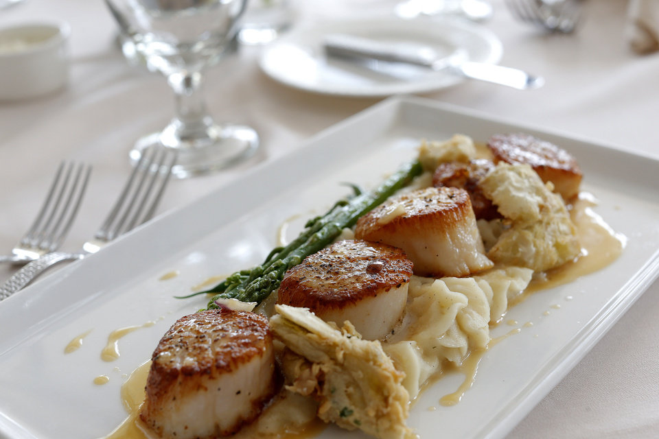 Photo - Pan-seared scallops are served with Boursin-whipped potatoes with honey beurre blanc.  SARAH PHIPPS - SARAH PHIPPS