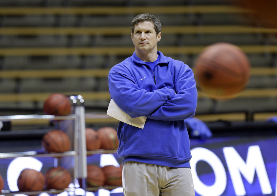 Photo - Florida Gulf Coast head coach Karl Smesko watches his team during practice at the women's NCAA college basketball tournament in West Lafayette, Ind., Friday, March 21, 2014.  Florida Gulf Coast plays Oklahoma State in a first-round game on Saturday.(AP Photo/Michael Conroy)