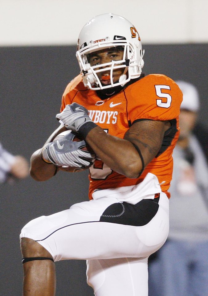 Photo - Keith Toston runs into the end zone for the Cowboys first TD during the college football game between Oklahoma State University (OSU) and the University of Missouri (MU) at Boone Pickens Stadium in Stillwater, Okla. Saturday, Oct. 17, 2009.  Photo by Steve Sisney, The Oklahoman