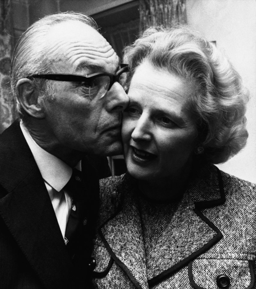 Photo - FILE - In a Feb. 4, 1975 file photo, Margaret Thatcher gets a kiss  from her husband Denis in London, Feb. 4, 1975, after she had come out on top with 130 votes in the first round of the election for the Conservative party leadership. Thatchers former spokesman, Tim Bell, said that the former British Prime Minister Margaret Thatcher had died Monday morning, April 8, 2013, of a stroke.  She was 87 years old. (AP Photo/File)